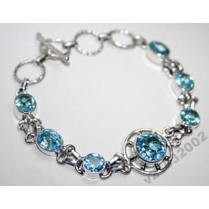 Топаз SWISS BLUE в серебряном браслете