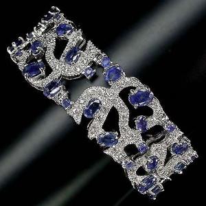 Дизайн ЦАРСКИЙ: САПФИР синий природный натуральный. Золото, серебро, россыпь белых ТОПАЗОВ. Браслет