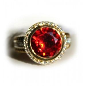 Кольцо с ярко оранжевым сверкающим фианитом в золоте и серебре